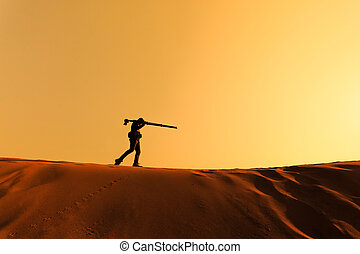 A man walking on sand desert