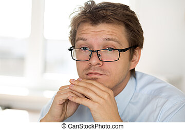 Portrait of frustrated business man wearing glasses....