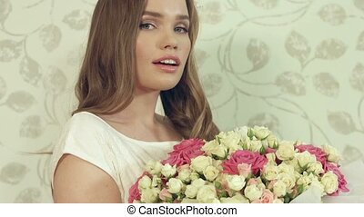 Beautiful girl surprised to get huge bouquet of roses