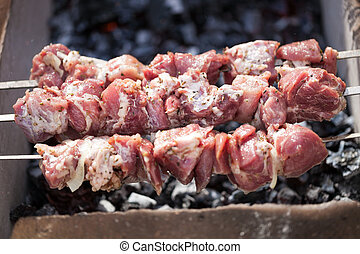 Marinated pork barbeque cooked on grill - Macro of grilled...