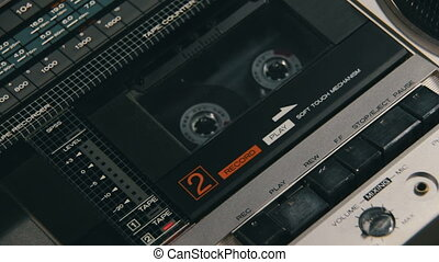 Insert Audio Cassettes into the Tape Player and Pushing Play, Stop Buttons