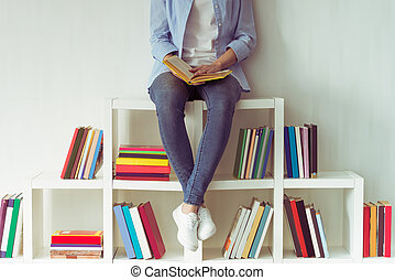 Girl with books - Beautiful young girl in jeans is holding a...