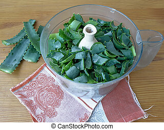 Aloe leaves on the table in food processor, going to make...