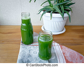 Aloe juice on the table in bottles, for good health