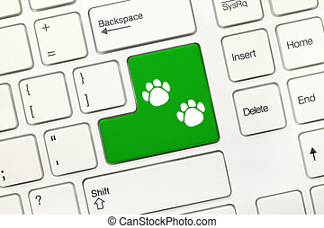 White conceptual keyboard - Green key with dog footprints...