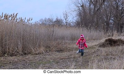 Girl in zelenke running on grass