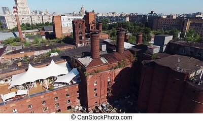 Quadrocopter shoot summer restaurant on roof of brick...
