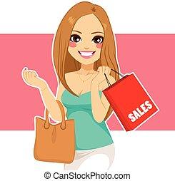 Woman Shopping Bag - Beautiful young blonde woman shopping...