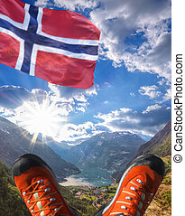 Geiranger fjord with flag of Norway