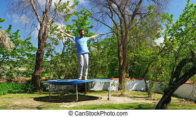 """Happy man jumping playing on trampoline, freedom happiness concept"""