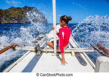 Girl on a boat - Beautiful young girl on a boat at a sunny...