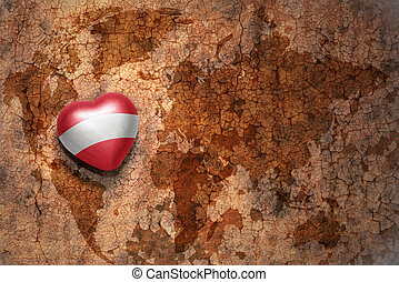 heart with national flag of austria on a vintage world map...