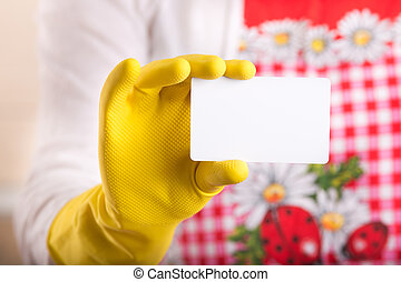 Cleaning lady showing business card - Close up of female...