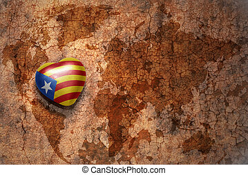 heart with national flag of catalonia on a vintage world map...