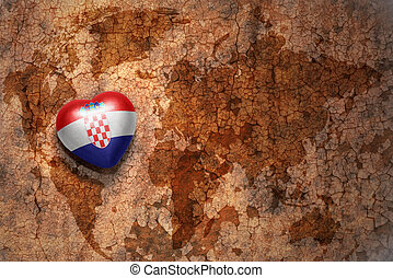 heart with national flag of croatia on a vintage world map...