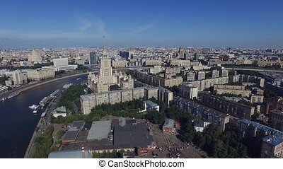 Quadrocopter fly over Moscow city in summer cloudless day. Cityscape.