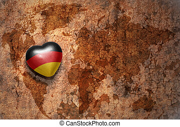heart with national flag of germany on a vintage world map...