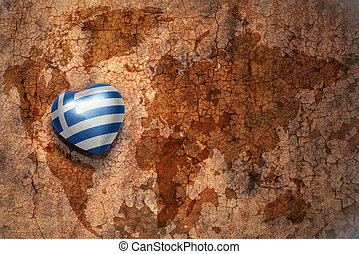 heart with national flag of greece on a vintage world map...