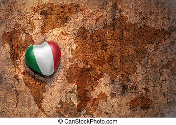 heart with national flag of italy on a vintage world map...
