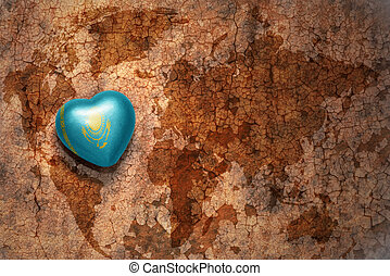 heart with national flag of kazakhstan on a vintage world...