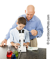Science Teacher Helps Student - Science teacher supervises a...