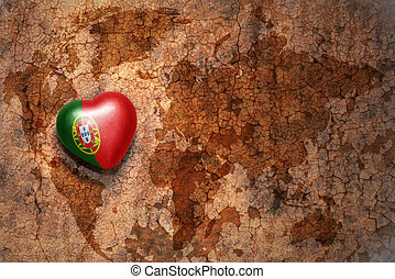 heart with national flag of portugal on a vintage world map...