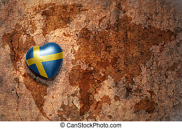 heart with national flag of sweden on a vintage world map...