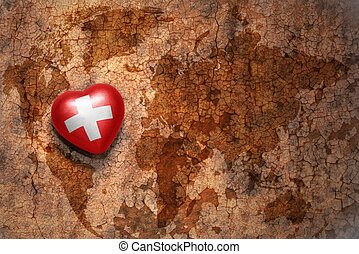 heart with national flag of switzerland on a vintage world...