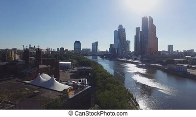 Quadrocopter shoot panorama of Moscow International Business Center from riverside. Summer sunny day