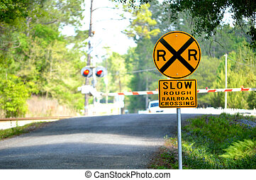 Slow Rough Railroad Crossing sign