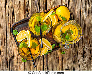 Lemon ice tea served on wooden table