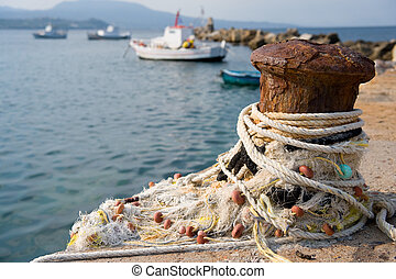 Fishery harbor with boats - Greek fishery harbor with ropes...