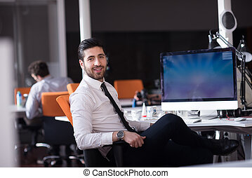 young business man working on desktop computer - happy young...