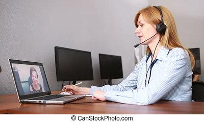 Female customer support operator. she leads online...