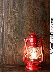 Lantern kerosene oil lamp, on wooden background