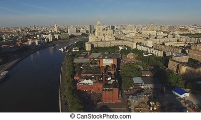 Quadrocopter fly over Moscow city in summer cloudless day. Modern and old edifices. Moscow river.