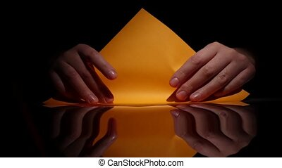 Origami of yellow paper. Black. Closeup - Origami of yellow...