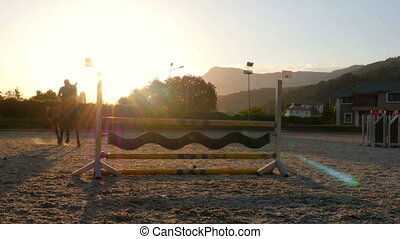 quot;Horse jumping hurdle at sunset, quot; - Horse jumping...
