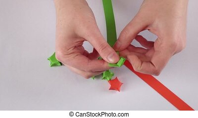 Colorful paper star White Time lapse - Hands make origami...