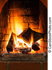 burning firewood in fire-box of fireplace in country cottage