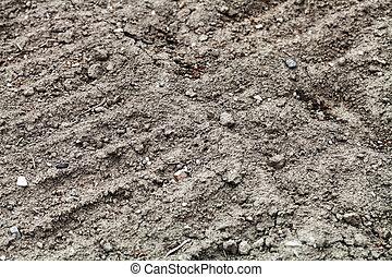 arable soil of vegetable garden - natural background -...
