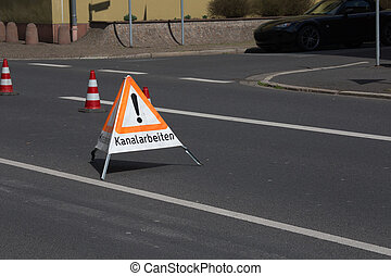 Sewerage works - A german folding sign on a road that says...