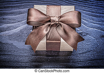 Gift box with present on wooden board directly above