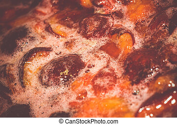 Boiling Plum Jam - Sweet plum jam with sugar syrup is...