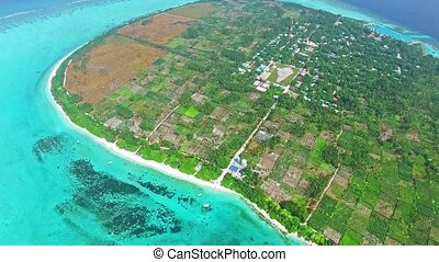 Maldivian island Thoddoo top birds eye view Indian Ocean