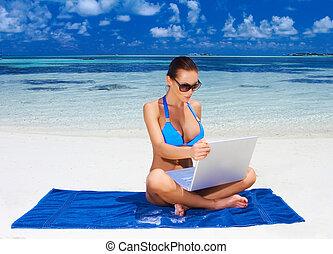 Woman at Maldives - Beautiful woman resting near water at...