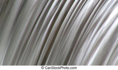 Water background - Detail of a small water cascade recorded...