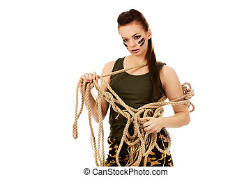 Young angry soldier woman tugging a rope.