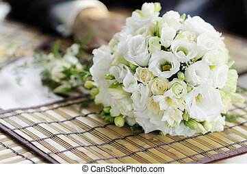 White wedding flowers laying on a table