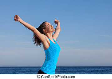 happy person arms raised outstretched